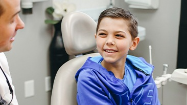 Little boy smiling at dentist during children's dentistry visit