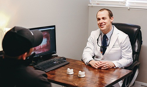 Dentist smiling at patient during dnetal veneer consultation
